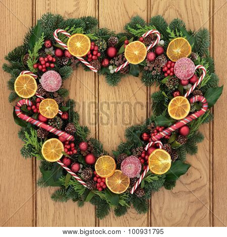 Christmas Heart Decoration.Christmas Heart Shaped Wreath With Dried Fruit Candy Canes