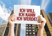 I Want I Can I Will (in German) placard with cityscape background poster