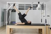 Постер, плакат: Man Doing Pilates In Cadillac