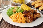 picture of biscuits gravy  - Fried chicken drumsticks with salad and macaroni and cheddar cheese - JPG