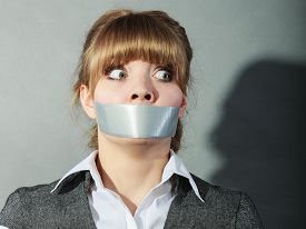 stock photo of freedom speech  - Scared woman with mouth taped shut - JPG