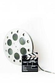 picture of mm  - Big movie reel and 35 mm film - JPG