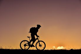 image of biker  - biker and sunrise - JPG
