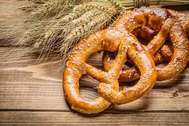 picture of pretzels  - fresh pretzel  and wheat on the wooden - JPG