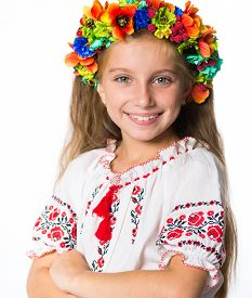 picture of national costume  - portrait of a happy little Ukrainian  girl in the national costume - JPG