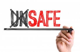 picture of unsafe  - Hand with marker writing the word Unsafe Safe - JPG