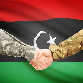 foto of libya  - Soldiers shaking hands with flag on background  - JPG