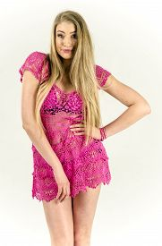 stock photo of tunic  - A girl in a light pink transparent tunic dress fun - JPG
