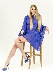 pic of tunic  - A girl in a light blue cape transparent tunic and high heels - JPG