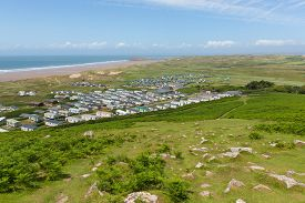 pic of caravan  - View from Rhossili Down to Burry Holms and Hillend The Gower peninsula Wales UK in summer with caravans - JPG