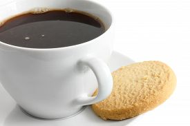 pic of shortbread  - Detail of a white ceramic cup of black coffee with shortbread biscuit.