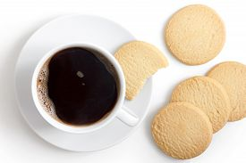 image of shortbread  - White cup of black coffee and saucer with shortbread biscuits from above - JPG