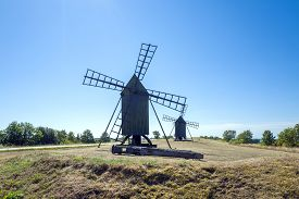 stock photo of windmills  - Traditional windmills on Swedish island Oland in the Baltic Sea - JPG