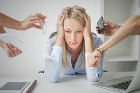 picture of fail job  - Depressed woman overloaded with stuff at work - JPG