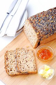 stock photo of fresh slice bread  - Fresh sliced whole wheat bread with butter and jam - JPG