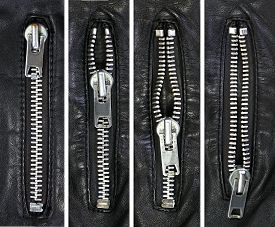 stock photo of zipper  - Zipper in different position on black leather - JPG