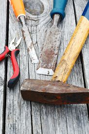 picture of chisel  - chisel and a hammer on the old boards - JPG