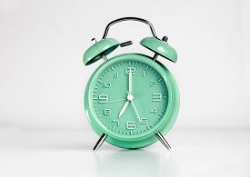 stock photo of analog clock  - Green analog retro twin bell alarm clock - JPG