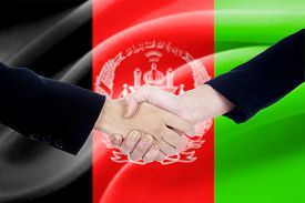 stock photo of politician  - Two politicians shaking hands in front of afghanistan flag background - JPG