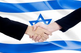 stock photo of politician  - Two politicians in business suit shaking hands in front of israel flag background - JPG