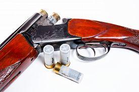 pic of shotgun  - Hunting shotgun and ammunition on white background - JPG