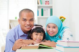 foto of malay  - malay family reading in the living room - JPG