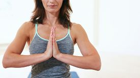 picture of mudra  - Cropped shot of fit woman practicing yoga in gym - JPG