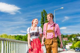 foto of national costume  - Couple visiting together Bavarian fair in national costume leather pants and Dirndl  - JPG