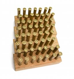picture of revolver  - Old revolver cartridges stored in wooden blocks on a white background - JPG