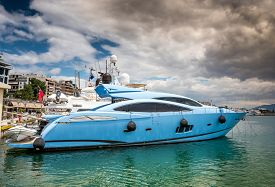 image of piraeus  - Fast and luxury yacht under a heavy cloudscape at marina Zeas Piraeus Greece - JPG