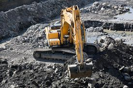 stock photo of excavator  - Gravel excavated in the mainstream of the river  - JPG