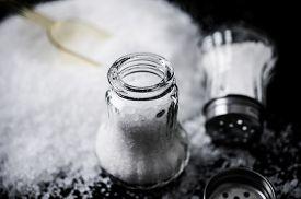picture of salt shaker  - Two glass salt shakers and salt closeup - JPG