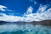 Totora boat on the Titicaca lake near Puno, Peru poster