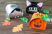 The Child Creates A Gift Box Of A Black Cat Of Halloween, A Halloween Pumpkin And A Vampire Box. Chi poster