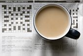 A Cup Of Tea On A Newspaper Showing The Crossword