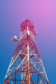 Mobile Phone Communication Antenna Tower With Satellite Dish On Blue Sky Background Soft Tone. poster