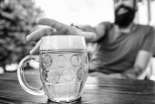 Mug Cold Fresh Beer On Table Close Up. Distinct Beer Culture. Man Sit Cafe Terrace Enjoying Beer Def poster