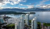 Aerial View Of Vancouver Harbor From Downtown Vancouver And North Vancouver On The Opposite Shore Of poster