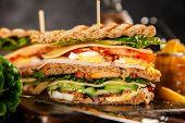 Tall club sandwich on dark background poster