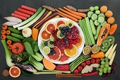 Health food for healthy eating for vegans & vegetarians with with fresh fruit, vegetables, herbs ad  poster