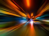Abstract Speed Motion Blur In City On Night Road And Neon Light. poster
