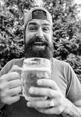Man Relaxing Enjoying Beer Hot Summer Day. Beer And Ale Concept. Quench Thirst. Hipster Brutal Beard poster