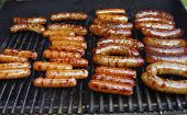 picture of nic  - Gas grill with Hot dogs and Bratwurst grilled to a golden brown - JPG