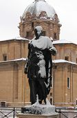 Statue of roman emperor Julius Caesar under snow