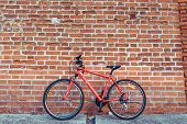 Red City Bike In The Summer In City On A Brick Wall Background. The Concept Of Parking, Bike, Rest I poster
