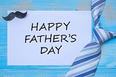 Happy Fathers Day With Blue Neckties And Mustache On Wooden Background.  International Mens Day Co poster