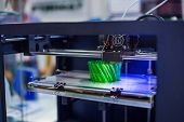 Automatic Three Dimensional 3d Printer Machine Printing Plastic Model At Modern Technology Exhibitio poster