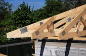 Roofing Construction House Corner Roof With Wooden Beams, Trusses, Frame, Timber And Measurement Tap poster