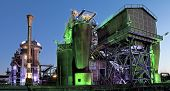 pic of blast-furnace  - steel industry blast furnace factory or plant abandoned old industrial architecture at night with colored lights Landschaftspark Duisburg - JPG