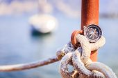 Sailing: Nautical Compass On A Sailing Rope, Pier. Sailing Boats In The Background. poster
